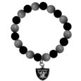 Oakland Raiders Fan Bead Bracelet - Flash your Oakland Raiders spirit with this bright stretch bracelet. This new bracelet features multicolored team beads on stretch cord with a nickel-free enameled chrome team charm. This bracelet adds the perfect pop of color to your game day accessories. Officially licensed NFL product Licensee: Siskiyou Buckle Thank you for visiting CrazedOutSports.com