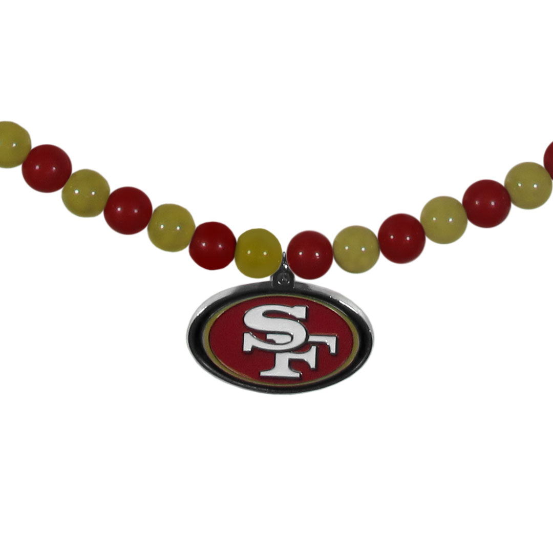 San Francisco 49ers Fan Bead Necklace - Make a big statement with our fan bead necklaces! These brightly colored necklace have a 24 inch string of alternating colored beads with an extra large, high-polish San Francisco 49ers pendant.