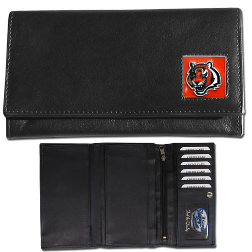 Women's NFL Leather Wallet - Cincinnati Bengals  - This genuine leather women's pocketbook features 9 credit card slots, a windowed ID slot, spacious front pocket, inner pocket and zippered coin pocket. The front of the pocketbook has a hand painted metal square with the team's primary logo. Officially licensed NFL product Licensee: Siskiyou Buckle .com