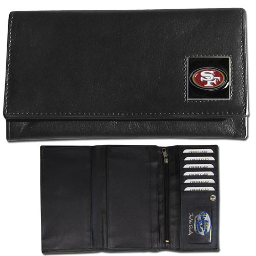 Women's NFL Leather Wallet - San Francisco 49ers - This genuine leather women's pocketbook features 9 credit card slots, a windowed ID slot, spacious front pocket, inner pocket and zippered coin pocket. The front of the pocketbook has a hand painted metal square with the team's primary logo. Officially licensed NFL product Licensee: Siskiyou Buckle .com