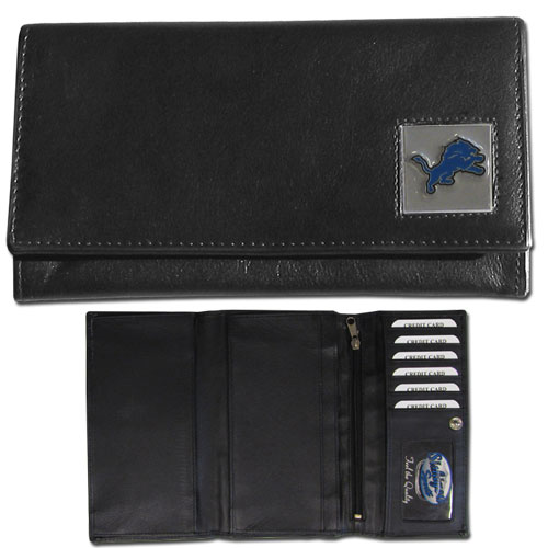 Women's NFL Leather Wallet -  Detroit Lions - This genuine leather women's pocketbook features 9 credit card slots, a windowed ID slot, spacious front pocket, inner pocket and zippered coin pocket. The front of the pocketbook has a hand painted metal square with the team's primary logo. Officially licensed NFL product Licensee: Siskiyou Buckle .com