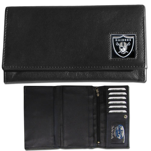 Women's NFL Leather Wallet - Oakland Raiders - This genuine leather women's pocketbook features 9 credit card slots, a windowed ID slot, spacious front pocket, inner pocket and zippered coin pocket. The front of the pocketbook has a hand painted metal square with the team's primary logo. Officially licensed NFL product Licensee: Siskiyou Buckle Thank you for visiting CrazedOutSports.com