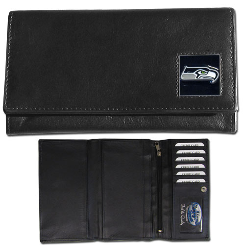 Women's NFL Leather Wallet -  Seattle Seahawks - This genuine leather women's pocketbook features 9 credit card slots, a windowed ID slot, spacious front pocket, inner pocket and zippered coin pocket. The front of the pocketbook has a hand painted metal square with the team's primary logo. Officially licensed NFL product Licensee: Siskiyou Buckle .com