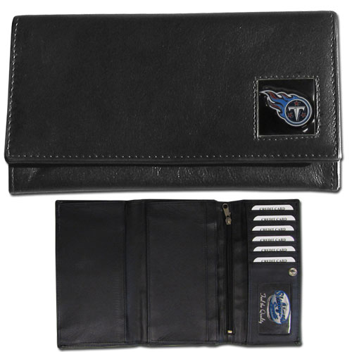 Women's NFL Leather Wallet - Tennessee Titans - This genuine leather women's pocketbook features 9 credit card slots, a windowed ID slot, spacious front pocket, inner pocket and zippered coin pocket. The front of the pocketbook has a hand painted metal square with the team's primary logo. Officially licensed NFL product Licensee: Siskiyou Buckle .com
