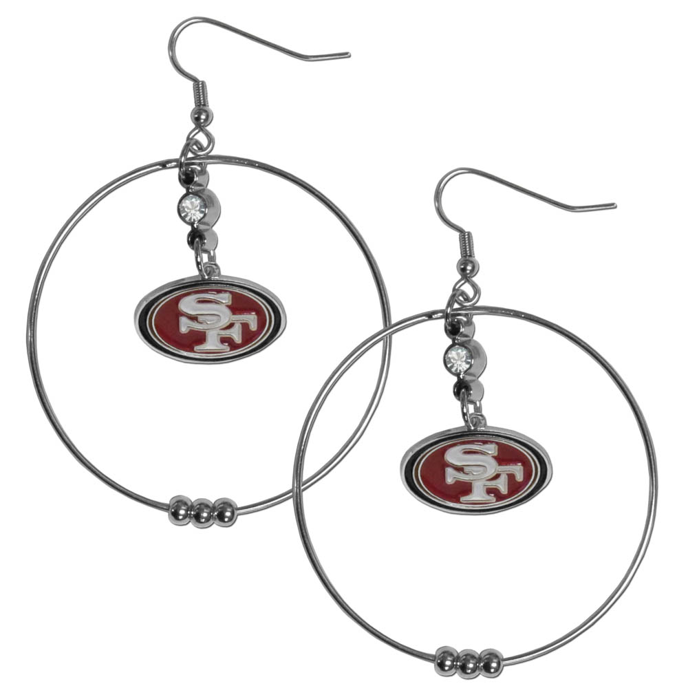 San Francisco 49ers 2 Inch Hoop Earrings - Our large hoop earrings have a fully cast and enameled San Francisco 49ers charm with enameled detail and a high polish nickel free chrome finish and rhinestone access. Hypoallergenic fishhook posts.
