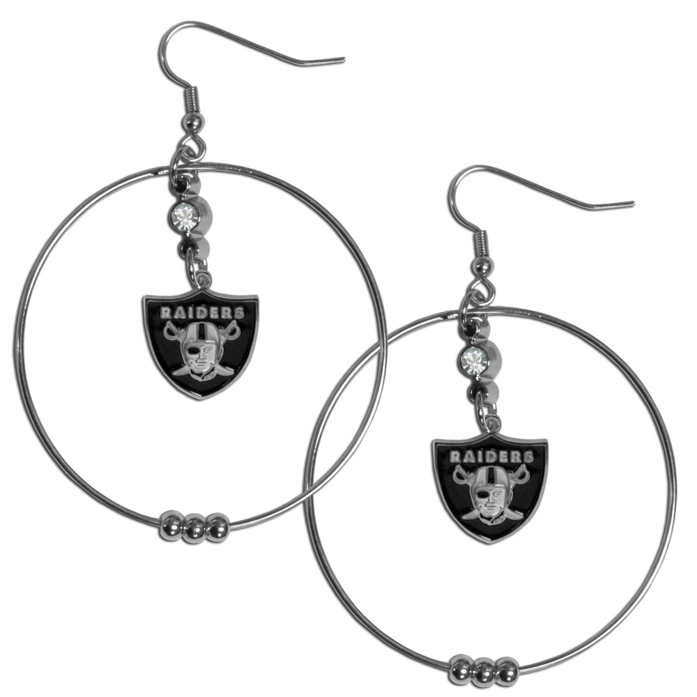 Oakland Raiders 2 Inch Hoop Earrings - Our large hoop earrings have a fully cast and enameled Oakland Raiders charm with enameled detail and a high polish nickel free chrome finish and rhinestone access. Hypoallergenic fishhook posts.