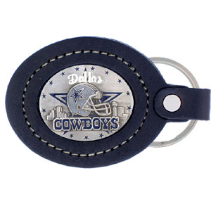 Large Leather Key Chain - Dallas Cowboys - This Dallas Cowboys key fob combines fine leather surrounding a sculpted & enameled team emblem. American craftsmanship makes this key ring a unique and long lasting gift. Made in America Officially licensed NFL product Licensee: Siskiyou Buckle .com