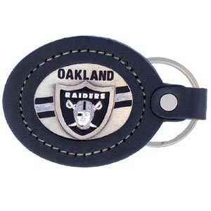 Large Leather Key Chain - Oakland Raiders - This Oakland Raiders key fob combines fine leather surrounding a sculpted & enameled team emblem. American craftsmanship makes this key ring a unique and long lasting gift. Made in America. Officially licensed NFL product Licensee: Siskiyou Buckle Thank you for visiting CrazedOutSports.com
