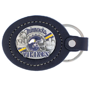 Large Leather Key Chain - Minnesota Vikings - This Minnesota Vikings key fob combines fine leather surrounding a sculpted & enameled team emblem. American craftsmanship makes this key ring a unique and long lasting gift. Made in America.  Officially licensed NFL product Licensee: Siskiyou Buckle .com