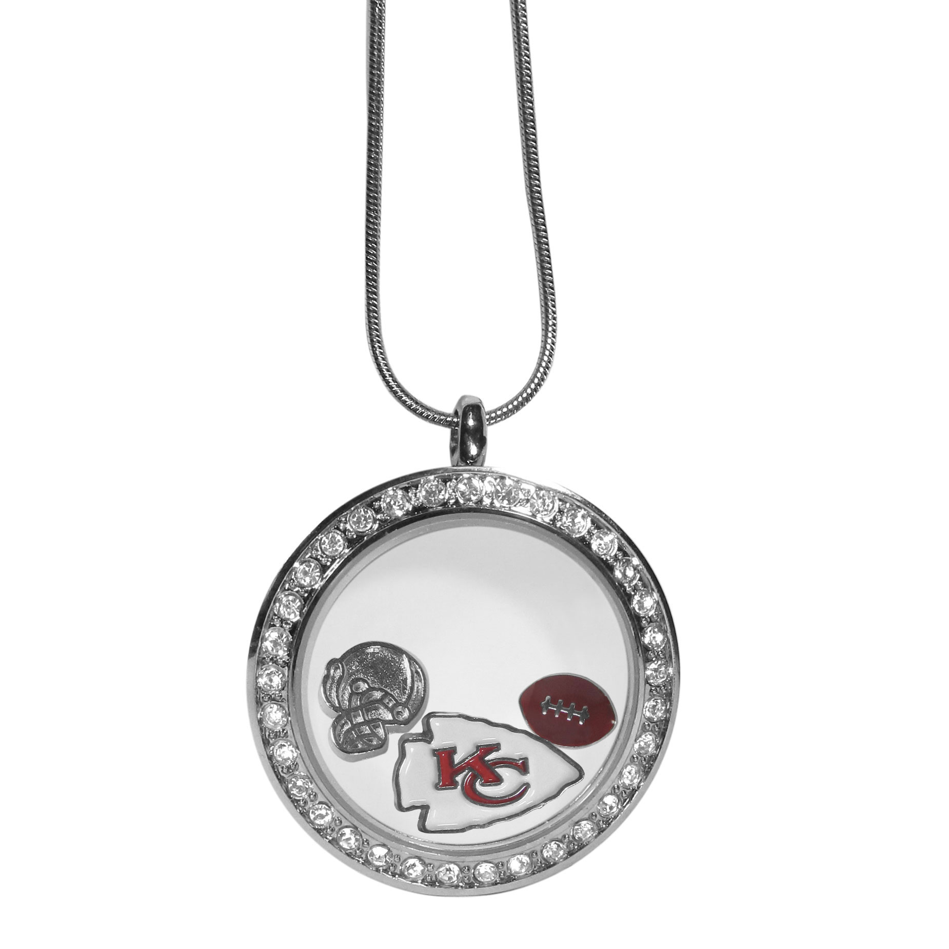 Kansas City Chiefs Locket Necklace - We have taken the classic floating charm locket and combined with licensed sports charms to create a must have fan necklace. The necklace comes with 3 charms; 1 Kansas City Chiefs charm, one football charm and one helmet charm. The charms float in a beautiful locket that has a strong magnetic closure with a rhinestone border. The locket comes on an 18 inch snake chain with 2 inch extender.