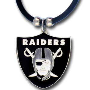 "NFL Logo Pendant - Oakland Raiders - NFL logo pendant strung on rubber cord.  Pendants are approximately 1 1/4"" h and enameled in vibrant color.  Features an easy to open/close clasp on a 22"" rubber cord necklace. Check out our entire line of  NFL jewelry. Officially licensed NFL product Licensee: Siskiyou Buckle Thank you for visiting CrazedOutSports.com"