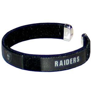 Oakland Raiders Fan Band Bracelet - Our NFL Oakland Raiders fan band is a one size fits all string cuff bracelets with a Oakland Raiders screen printed ribbon with the Oakland Raiders name and Oakland Raiders logo. Officially licensed NFL product Licensee: Siskiyou Buckle Thank you for visiting CrazedOutSports.com