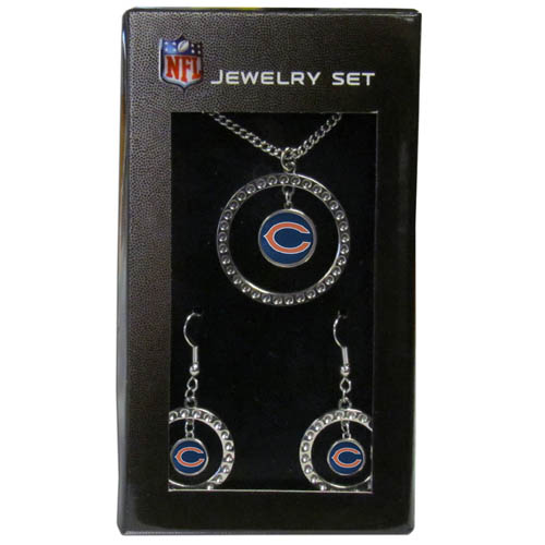 "Chicago Bears Rhinestone Jewelry Set - This officially licensed NFL Chicago Bears jewelry set includes our Chicago Bears rhinestone hoop earrings and Chicago Bears pendant in an NFL gift box. The 1"" Chicago Bears rhinestone hoop pendant comes on an 18"" chain and is paired with the matching Chicago Bears dangle hoop earrings. Officially licensed NFL product Licensee: Siskiyou Buckle .com"