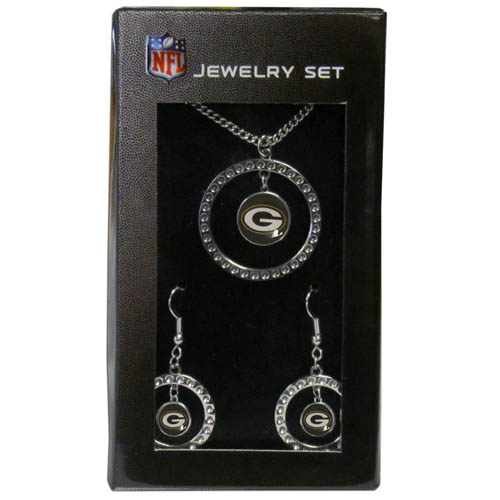"Green Bay Packers Rhinestone Jewelry Set - This officially licensed NFL Green Bay Packers jewelry set includes our Green Bay Packers rhinestone hoop earrings and Green Bay Packers pendant in an NFL gift box. The 1"" Green Bay Packers rhinestone hoop pendant comes on an 18"" chain and is paired with the matching Green Bay Packers dangle hoop earrings. Officially licensed NFL product Licensee: Siskiyou Buckle Thank you for visiting CrazedOutSports.com"