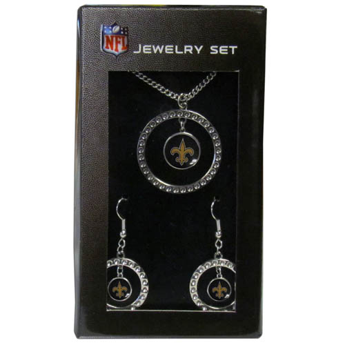 "New Orleans Saints Rhinestone Jewelry Set - This officially licensed NFL New Orleans Saints jewelry set includes our New Orleans Saints rhinestone hoop earrings and New Orleans Saints pendant in an NFL gift box. The 1"" New Orleans Saints rhinestone hoop pendant comes on an 18"" chain and is paired with the matching New Orleans Saints dangle hoop earrings. Officially licensed NFL product Licensee: Siskiyou Buckle Thank you for visiting CrazedOutSports.com"