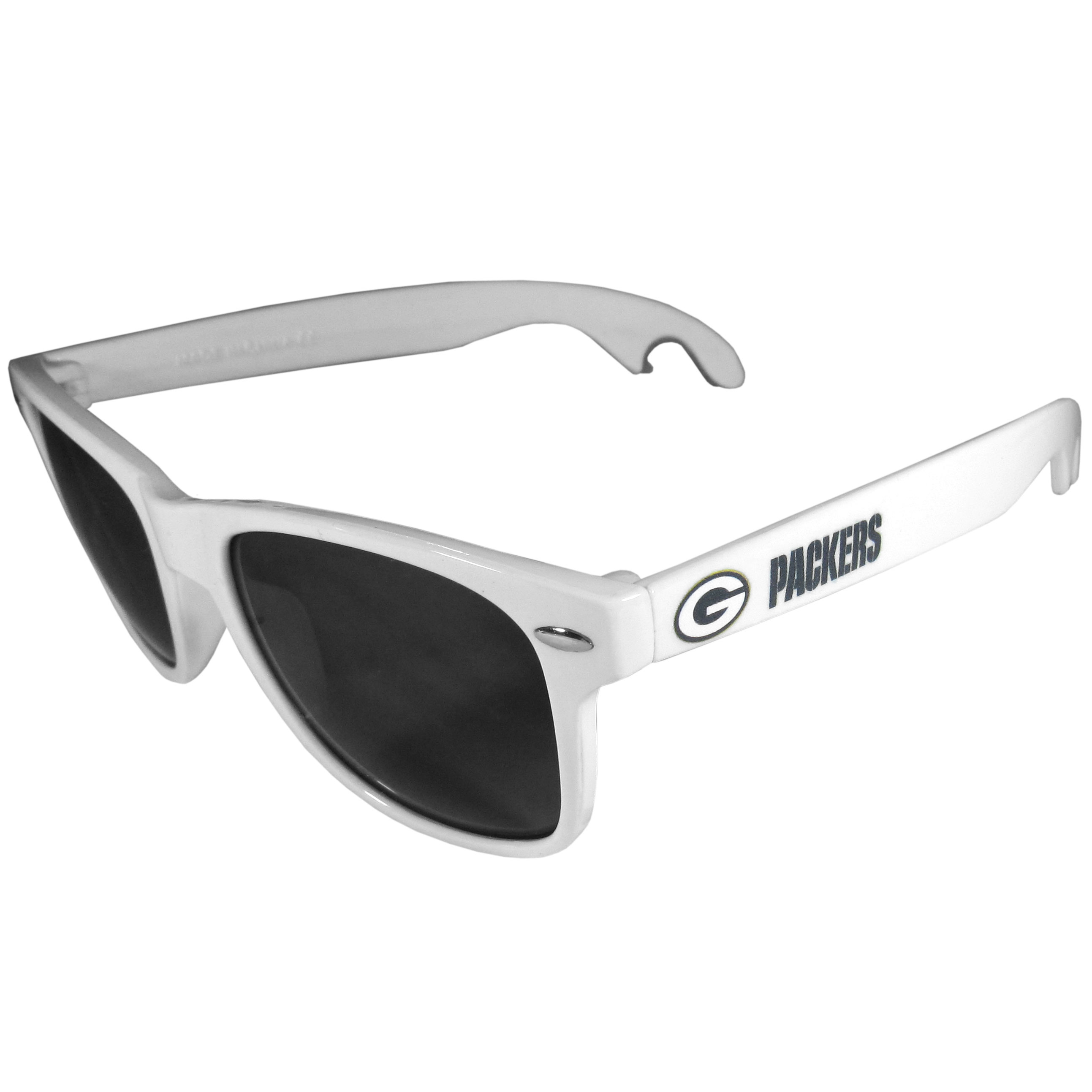 Green Bay Packers Beachfarer Bottle Opener Sunglasses, White - Seriously, these sunglasses open bottles! Keep the party going with these amazing Green Bay Packers bottle opener sunglasses. The stylish retro frames feature team designs on the arms and functional bottle openers on the end of the arms. Whether you are at the beach or having a backyard BBQ on game day, these shades will keep your eyes protected with 100% UVA/UVB protection and keep you hydrated with the handy bottle opener arms.