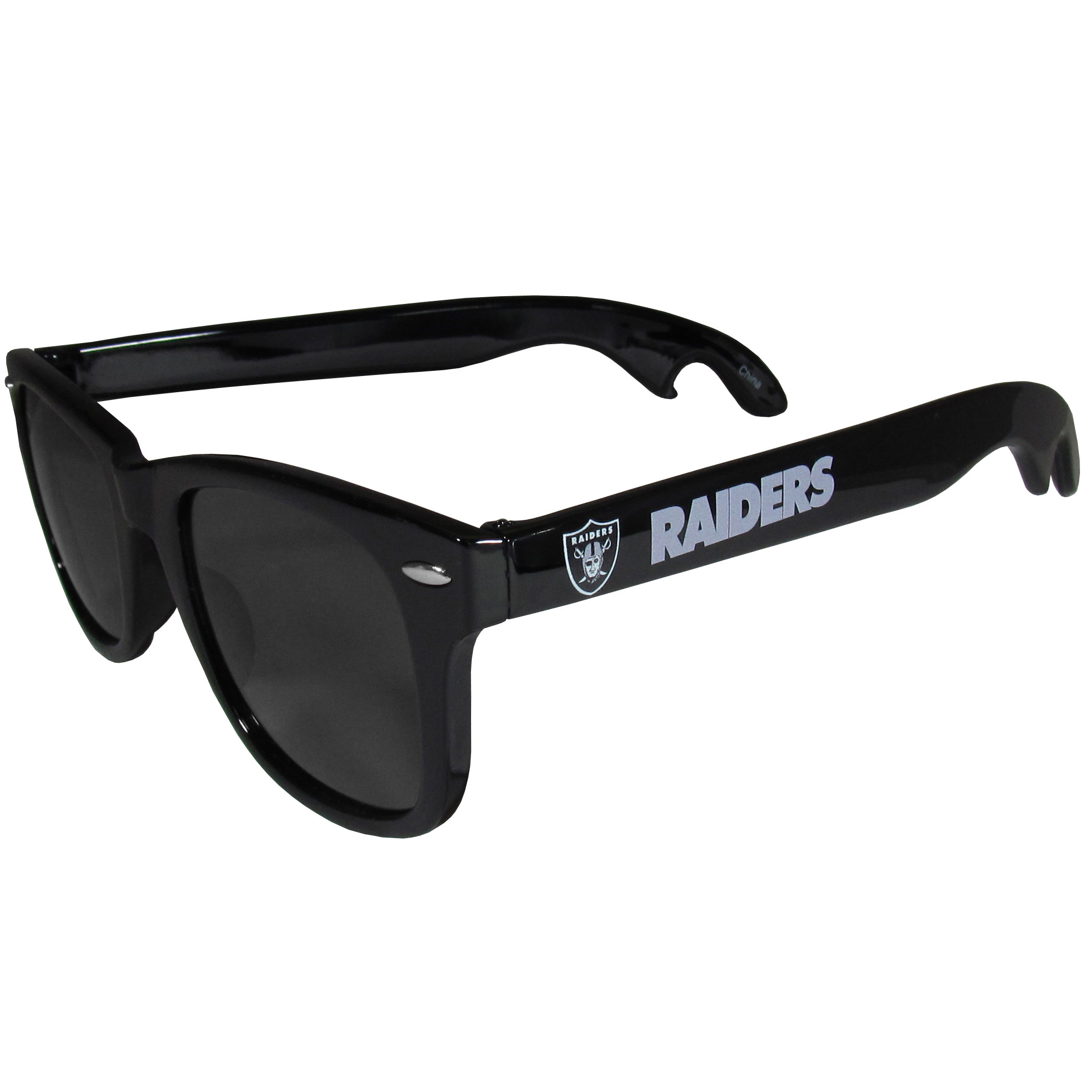 Oakland Raiders Beachfarer Bottle Opener Sunglasses - Seriously, these sunglasses open bottles! Keep the party going with these amazing Oakland Raiders bottle opener sunglasses. The stylish retro frames feature team designs on the arms and functional bottle openers on the end of the arms. Whether you are at the beach or having a backyard BBQ on game day, these shades will keep your eyes protected with 100% UVA/UVB protection and keep you hydrated with the handy bottle opener arms.