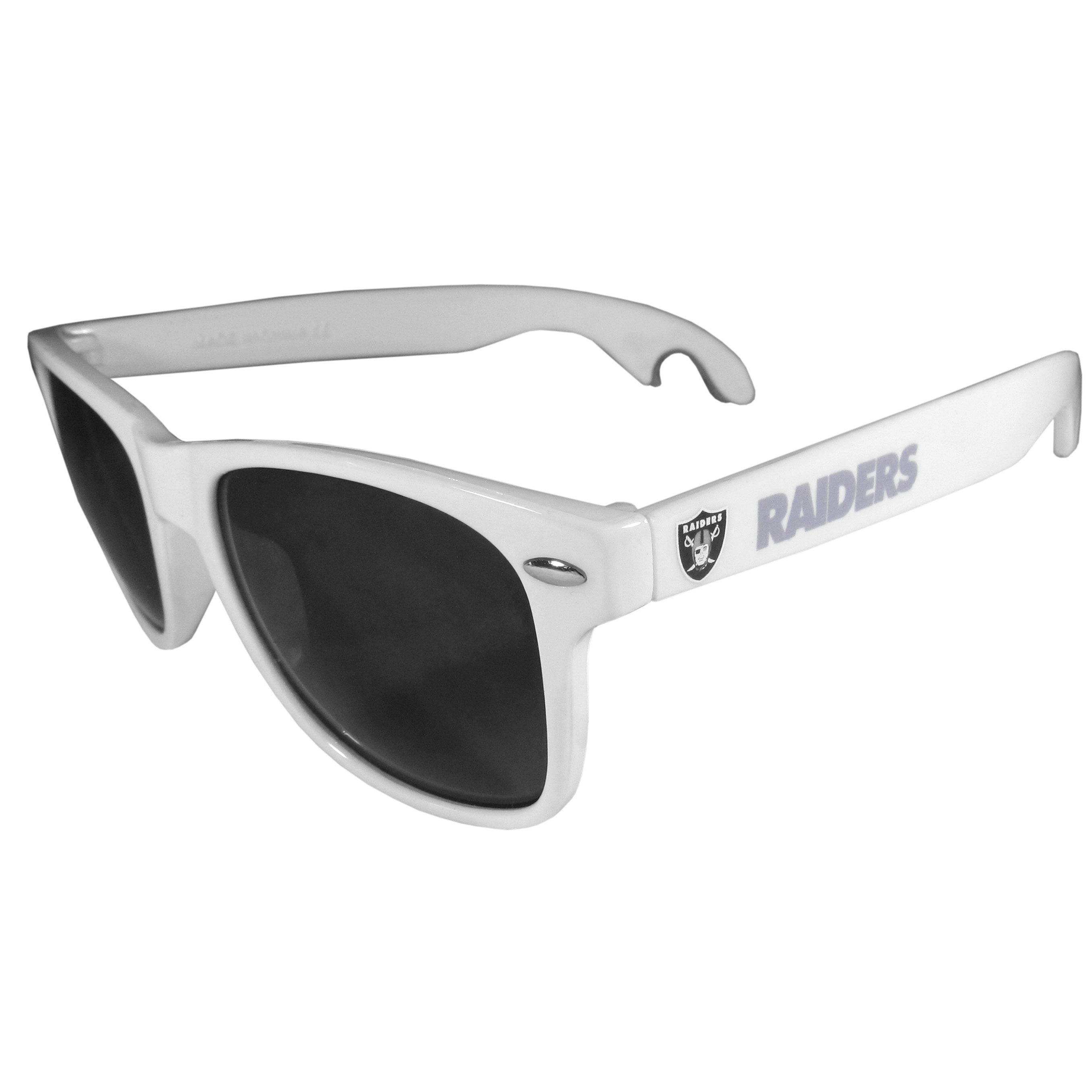 Oakland Raiders Beachfarer Bottle Opener Sunglasses, White - Seriously, these sunglasses open bottles! Keep the party going with these amazing Oakland Raiders bottle opener sunglasses. The stylish retro frames feature team designs on the arms and functional bottle openers on the end of the arms. Whether you are at the beach or having a backyard BBQ on game day, these shades will keep your eyes protected with 100% UVA/UVB protection and keep you hydrated with the handy bottle opener arms.