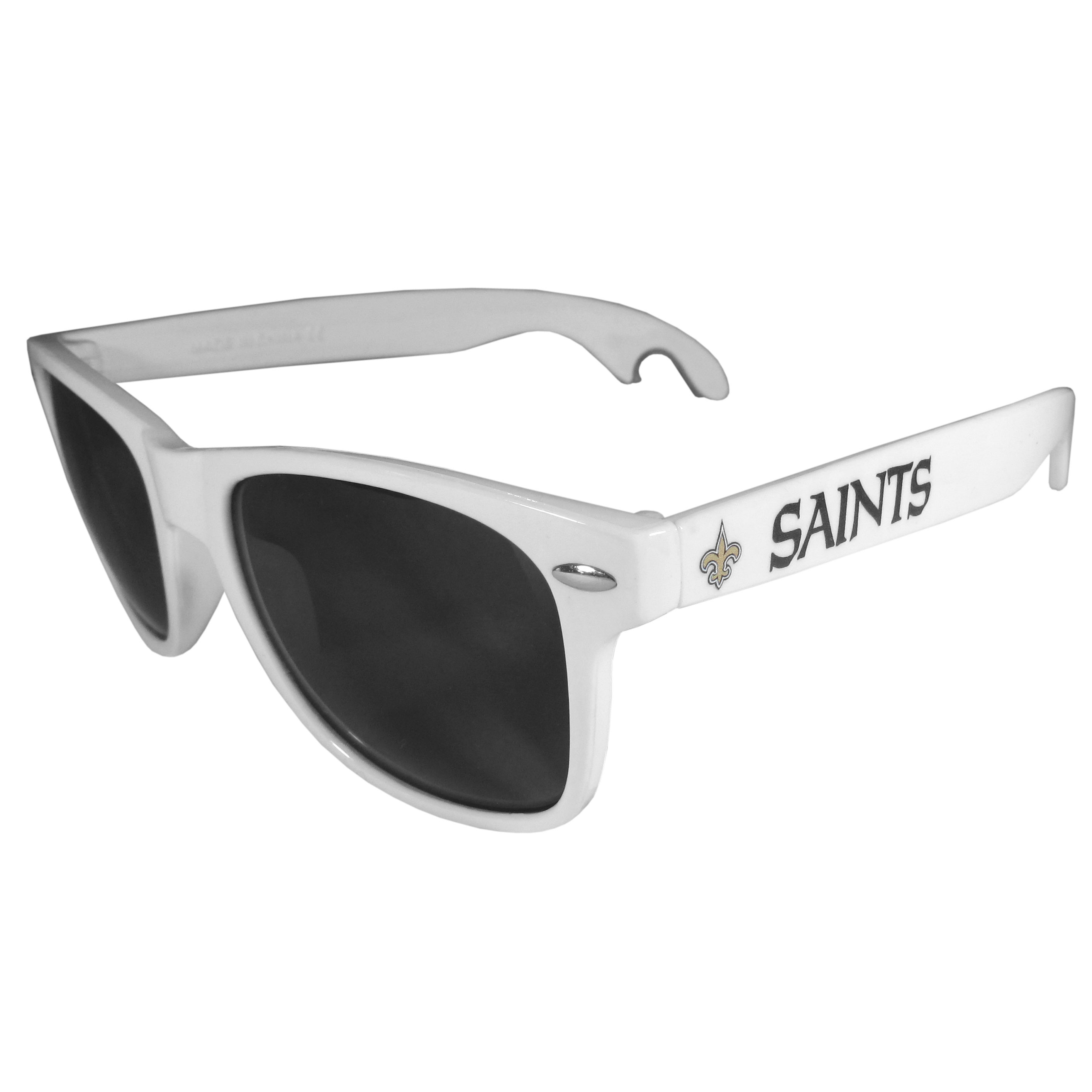New Orleans Saints Beachfarer Bottle Opener Sunglasses, White - Seriously, these sunglasses open bottles! Keep the party going with these amazing New Orleans Saints bottle opener sunglasses. The stylish retro frames feature team designs on the arms and functional bottle openers on the end of the arms. Whether you are at the beach or having a backyard BBQ on game day, these shades will keep your eyes protected with 100% UVA/UVB protection and keep you hydrated with the handy bottle opener arms.
