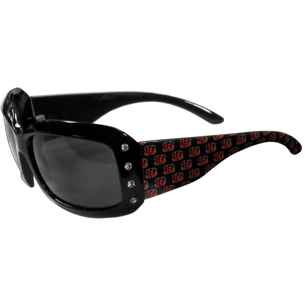 Cincinnati Bengals Designer Women's Sunglasses - Our designer women's sunglasses have a repeating Cincinnati Bengals logo design on the team colored arms and rhinestone accents. 100% UVA/UVB protection.
