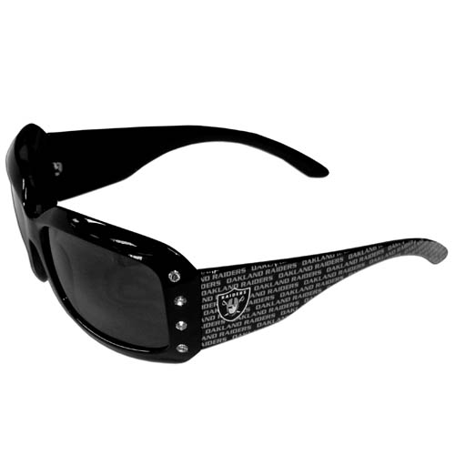 Oakland Raiders Designer Women's Sunglasses - Our designer women's sunglasses have a repeating Oakland Raiders logo design on the team colored arms and rhinestone accents. 100% UVA/UVB protection.