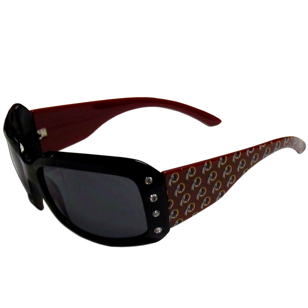 Washington Redskins Designer Women's Sunglasses - Our designer women's sunglasses have a repeating Washington Redskins logo design on the team colored arms and rhinestone accents. 100% UVA/UVB protection.