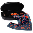 Chicago Bears Sunglass and Accessory Set - You'll never miss the game winning play when you have your Chicago Bears sunglass kit! Each kit comes with a hard shell zip case, a cleaning cloth and Siskiyou's popular wrap sunglasses!  The wrap sunglasses have the team logo screen printed on one side of the frame and the team name on the other side of the frame. The sunglass arms feature rubber team colored accents. Maximum UVA/UVB protection. The cleaning cloth features team logo and name in crisp clear graphics and helps keep your sunglasses smudge free. The kit also comes with a hard shell case that is lined with a microfiber interior to help keep your glasses scratch-free. Officially licensed NFL product Licensee: Siskiyou Buckle .com