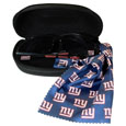 New York Giants Sunglass and Accessory Set - You'll never miss the game winning play when you have your New York Giants sunglass kit! Each kit comes with a hard shell zip case, a cleaning cloth and Siskiyou's popular wrap sunglasses!  The wrap sunglasses have the team logo screen printed on one side of the frame and the team name on the other side of the frame. The sunglass arms feature rubber team colored accents. Maximum UVA/UVB protection. The cleaning cloth features team logo and name in crisp clear graphics and helps keep your sunglasses smudge free. The kit also comes with a hard shell case that is lined with a microfiber interior to help keep your glasses scratch-free. Officially licensed NFL product Licensee: Siskiyou Buckle .com