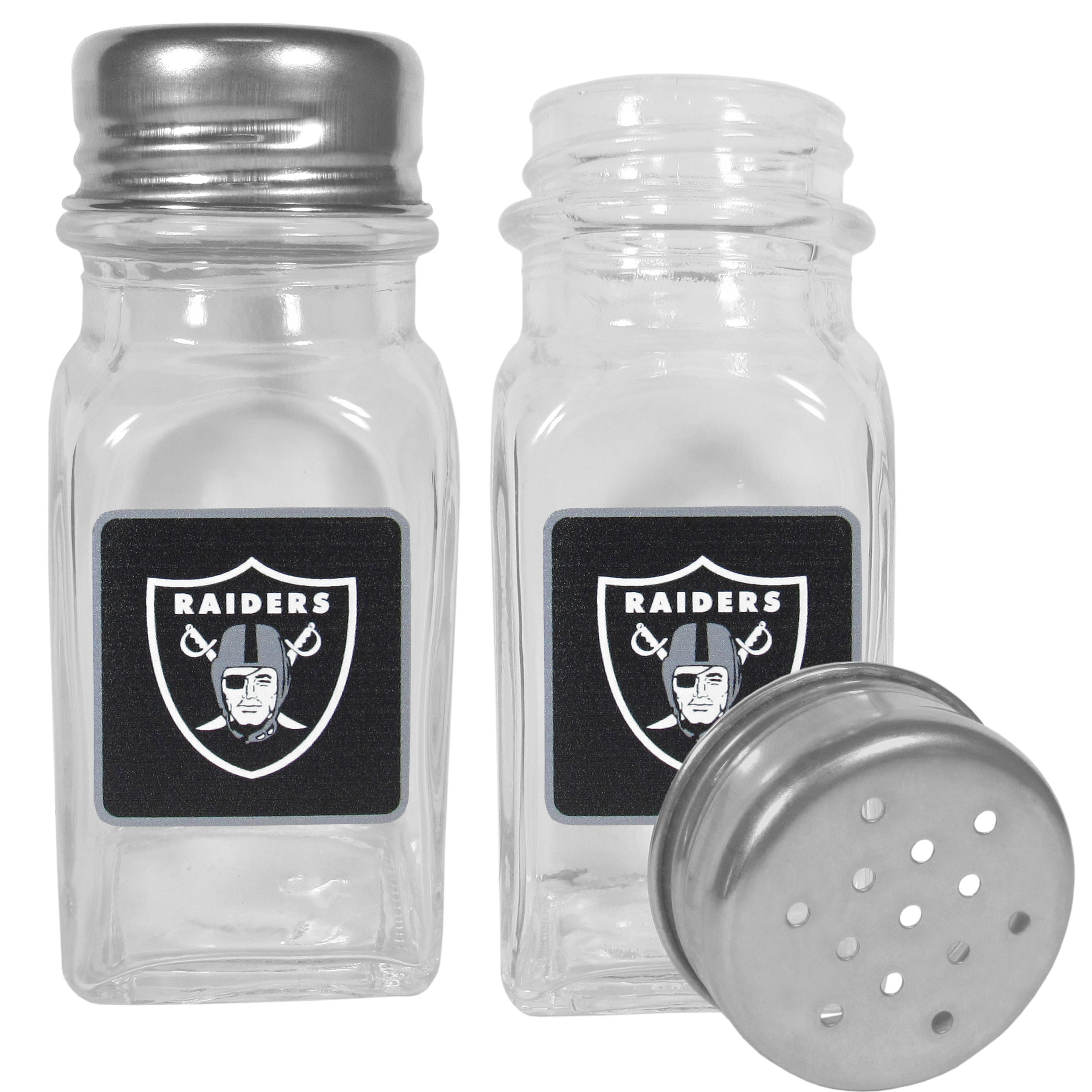 Oakland Raiders Graphics Salt and Pepper Shaker - No tailgate party is complete without your Oakland Raiders salt & pepper shakers featuring bright team logos. The diner replica salt and pepper shakers are glass with screw top lids. These team shakers are a great grill accessory whether you are barbecuing on the patio, picnicing or having a game day party.