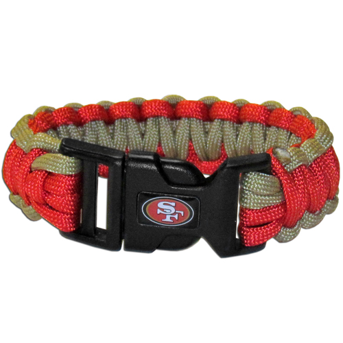 San Francisco 49ers Suvivor Bracelet - Our functional and fashionable survivor bracelets contain 2, 350lb test paracord rated cords that are each 5 feet long. The team colored cords can be pulled apart to be used in any number of emergencies and look great while worn. The bracelet features a team emblem on the clasp.  Officially licensed NFL product Licensee: Siskiyou Buckle .com