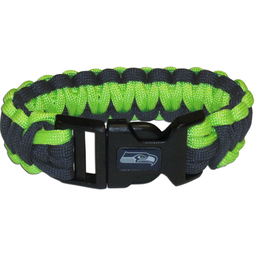 Seattle Seahawks Suvivor Bracelet - Our functional and fashionable survivor bracelets contain 2, 350lb test paracord rated cords that are each 5 feet long. The team colored cords can be pulled apart to be used in any number of emergencies and look great while worn. The bracelet features a team emblem on the clasp.  Officially licensed NFL product Licensee: Siskiyou Buckle .com