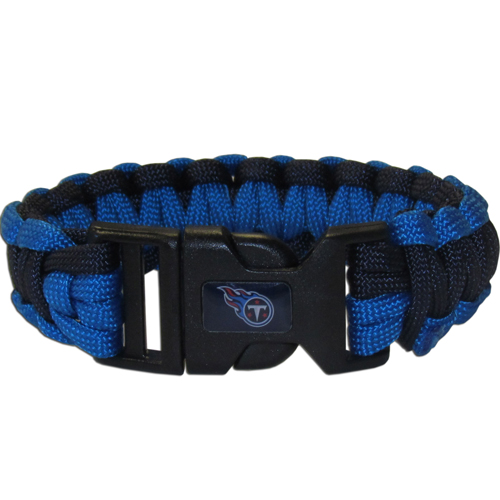 Tennessee Titans Suvivor Bracelet - Our functional and fashionable survivor bracelets contain 2, 350lb test paracord rated cords that are each 5 feet long. The team colored cords can be pulled apart to be used in any number of emergencies and look great while worn. The bracelet features a team emblem on the clasp.  Officially licensed NFL product Licensee: Siskiyou Buckle .com
