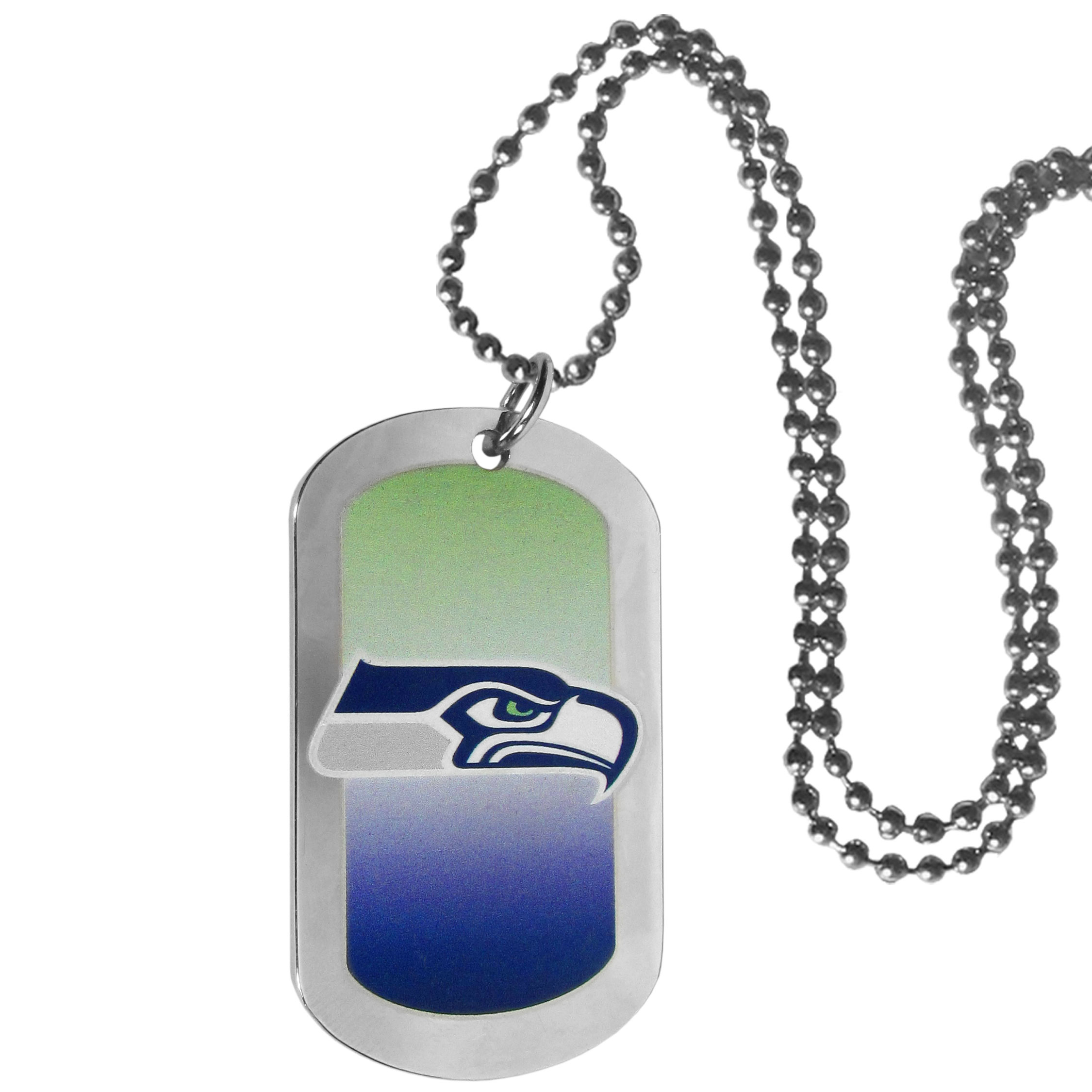 Seattle Seahawks Team Tag Necklace - Dog tag necklaces are a fashion statement that is here to stay. The sporty version of the classic tag features a gradient print in team colors featuring a full color team logo over a high polish tag to create a bold and sporty look. The tag comes on a 26 inch ball chain with a ball and joint clasp. Any Seattle Seahawks would be proud to wear this attractive fashion accessory.