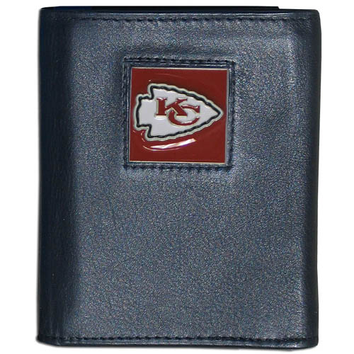 Kansas City Chief NFL Leather and Nylon Trifold Wallet - Officially licensed Kansas City Chief NFL collectors leather/nylon tri-fold wallet features a sculpted and hand painted Kansas City Chief square on a black leather trifold wallet. Includes an ID window, slots for credit cards and clear plastic photo sleeves. For a sporty feel, the liner of the Kansas City Chief NFL Leather and Nylon Trifold Wallet is made of high quality nylon. Officially licensed NFL product Licensee: Siskiyou Buckle Thank you for visiting CrazedOutSports.com