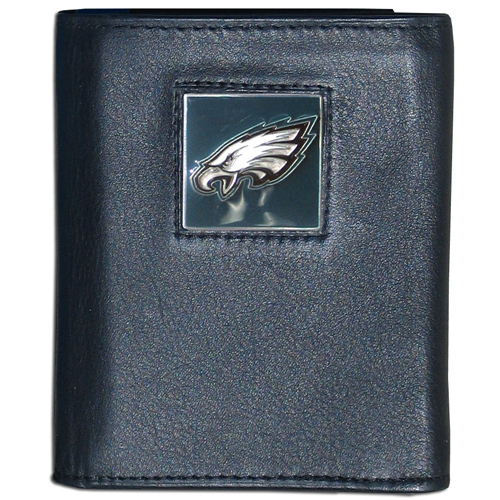 Philadelphia Eagles NFL Leather and Nylon Trifold Wallet  - Officially licensed Philadelphia Eagles NFL collectors leather/nylon tri-fold wallet features a sculpted and hand painted Philadelphia Eagles square on a black leather trifold wallet. Includes an ID window, slots for credit cards and clear plastic photo sleeves. For a sporty feel, the liner of the Philadelphia Eagles NFL Leather and Nylon Trifold Wallet is made of high quality nylon. Officially licensed NFL product Licensee: Siskiyou Buckle .com