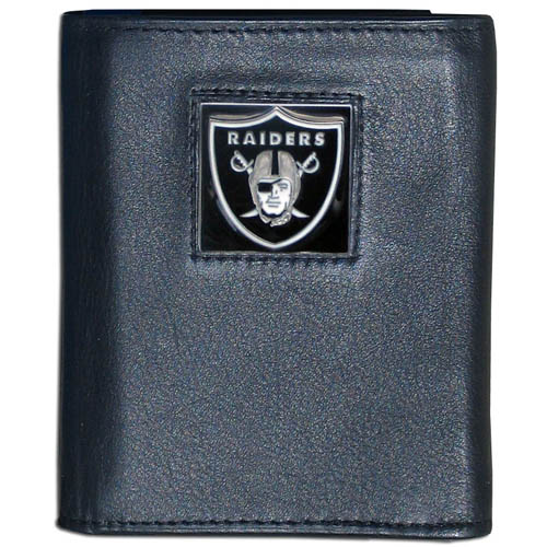 Oakland Raiders NFL Leather and Nylon Trifold Wallet  - Officially licensed Oakland Raiders NFL collectors leather/nylon tri-fold wallet features a sculpted and hand painted Oakland Raiders square on a black leather trifold wallet. Includes an ID window, slots for credit cards and clear plastic photo sleeves. For a sporty feel, the liner of the Oakland Raiders NFL Leather and Nylon Trifold Wallet is made of high quality nylon. Officially licensed NFL product Licensee: Siskiyou Buckle Thank you for visiting CrazedOutSports.com