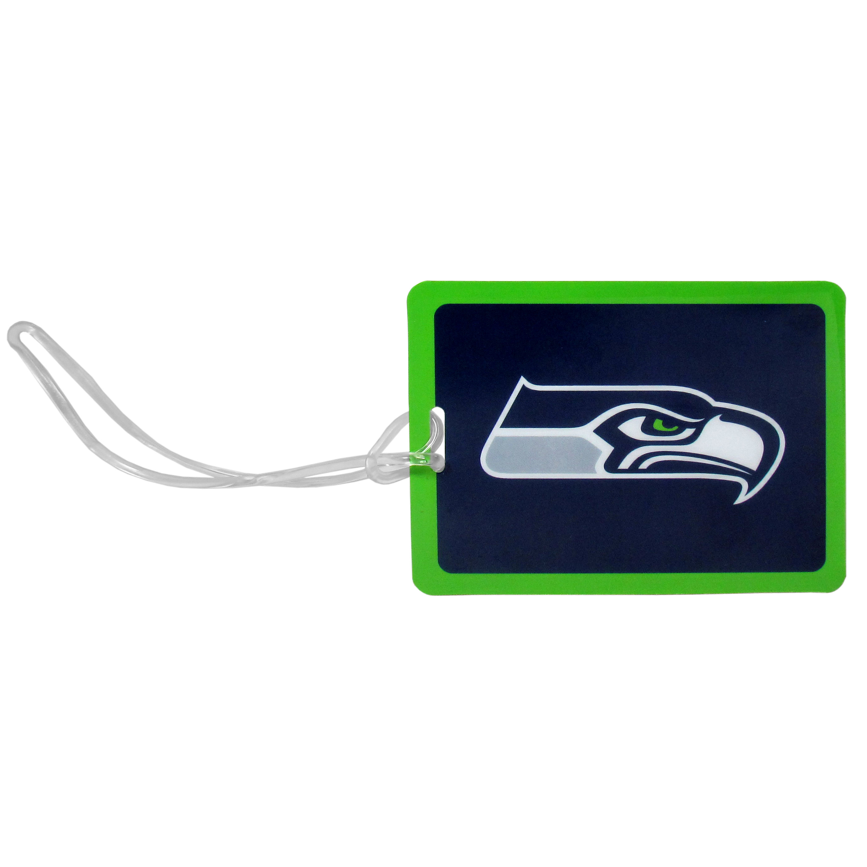 Seattle Seahawks Vinyl Luggage Tag - Tired of trying to spot your suitcase or bag in a sea of luggage? Try our large and colorful Seattle Seahawks luggage tag set. The tag is 4x3 inches and has a 5 inch cord to attach it easily to your bags, backpacks or luggage. The front of the tag features the team logo in a bright, team colored background and you can write you name, address and phone number on the back of the tag.