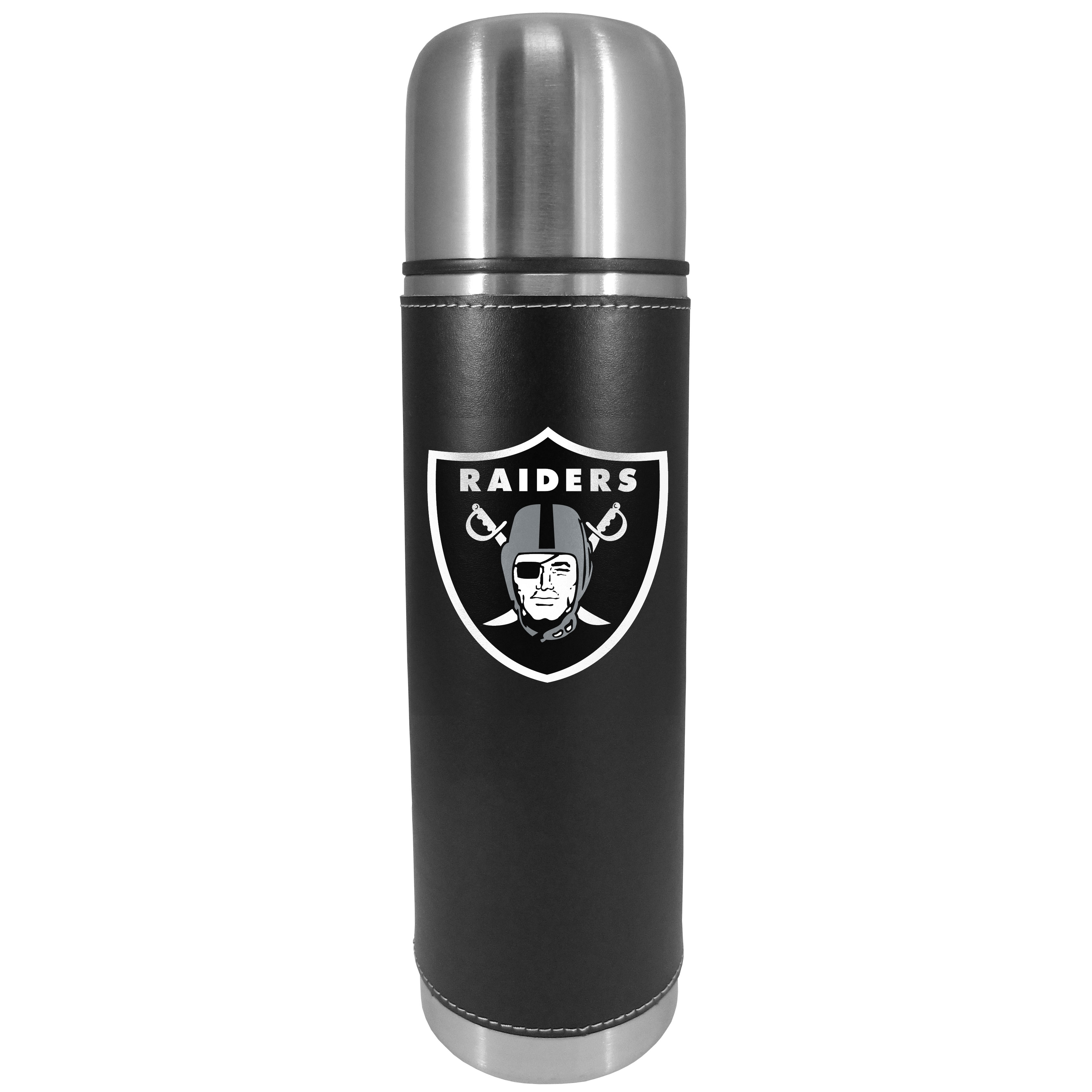 Oakland Raiders Graphics Thermos - This attractive, 26 ounce Oakland Raiders thermos is a great way to keep your beverages hot while on the go. The 11 inch tall, vacuum sealed thermos features a black vinyl wrap with stitched details and a digitally printed team logo. The lid screws on and can be used as a cup.