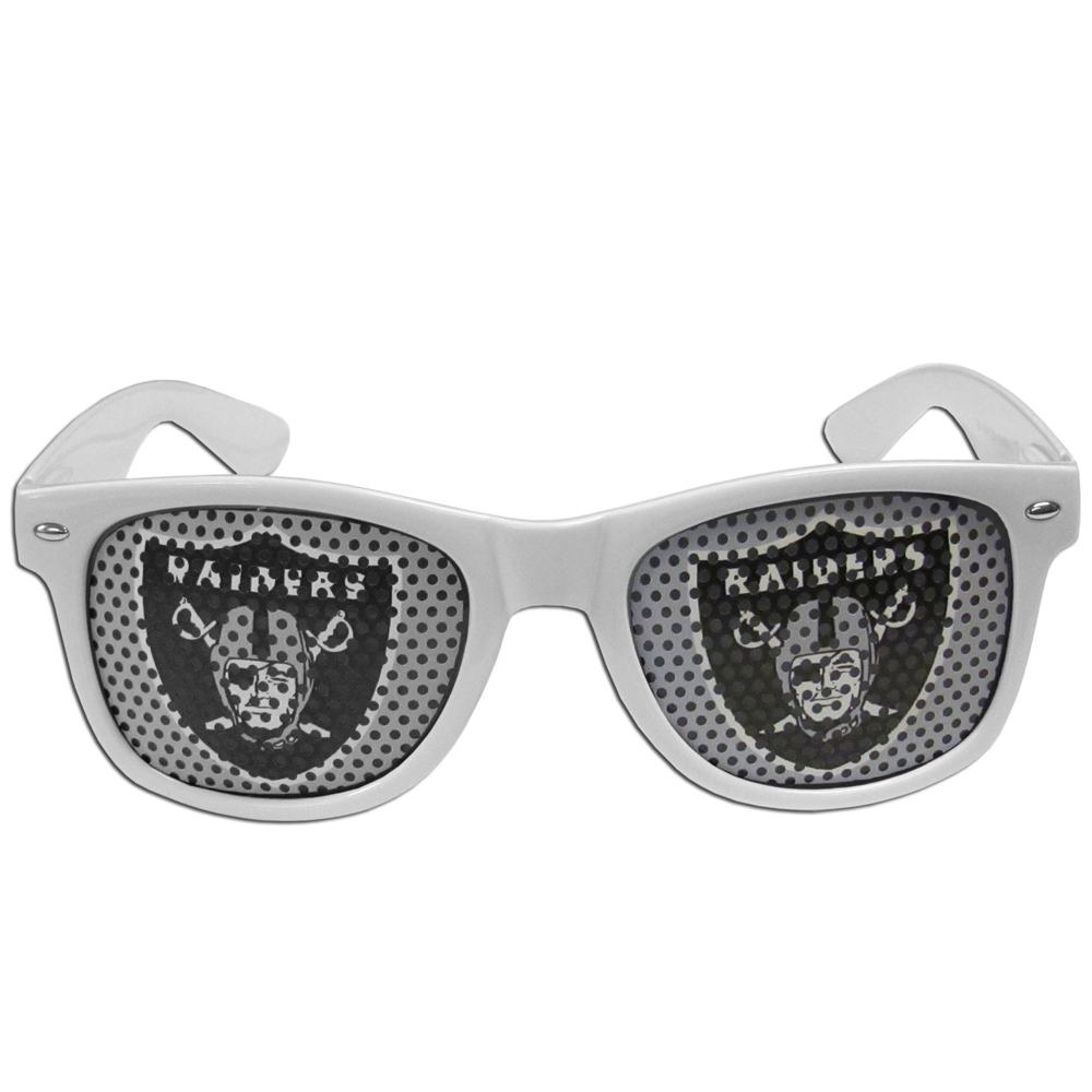 Oakland Raiders Game Day Shades - Our officially licensed game day shades are the perfect accessory for the devoted Oakland Raiders fan! The sunglasses have durable polycarbonate frames with flex hinges for comfort and damage resistance. The lenses feature brightly colored team clings that are perforated for visibility.