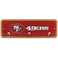 San Francisco 49ers Wall Mounted Key Rack - This 9 inch key rack has bright team graphics and 3 pegs to hang key chain from. The stamped aluminium frame is light weight and easy to hang.