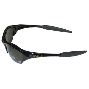 NFL Sunglasses - New Orleans Saints - Our sporty looking NFL sunglasses have the sports team logo screen printed both sides of the frames. The sunglass arms feature rubber team colored accents.  Look great in our sports memorabilia while rooting for your favorite sports team. Officially licensed NFL product Licensee: Siskiyou Buckle .com