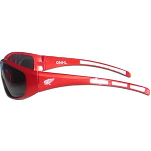 Detroit Red Wings Sunglasses - Detroit Red Wings NHL sunglasses have the Detroit Red Wings name screen printed on one side of the frames and the Detroit Red Wings logo on the other side of the frames. The Detroit Red Wings Sunglasses arms feature rubber team colored accents. Thank you for visiting CrazedOutSports