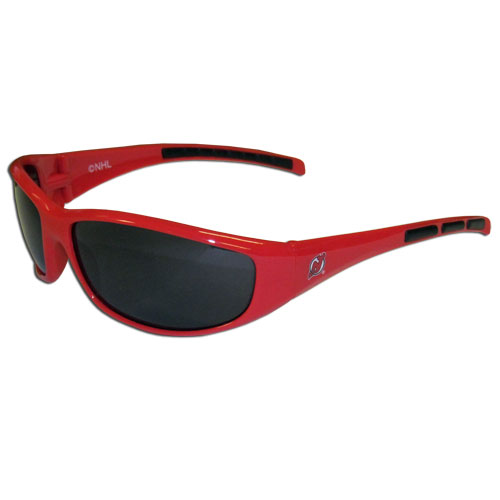 New Jersey Devils Wrap Sunglasses - These New Jersey Devils Wrap Sunglasses have the New Jersey Devils logo screen printed on one side of the frames and the New Jersey Devils logo on the other side of the frames. The New Jersey Devils Wrap Sunglass arms feature rubber New Jersey Devils colored accents. Maximum UVA/UVB protection.