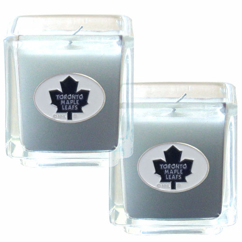 "NHL Candle Set - Toronto Maple Leafs - The NHL Toronto Maple Leafs Candle Set includes two 2"" x 2"" vanilla scented candles featuring a metal square with a hand enameled Toronto Maple Leafs emblem. Check out our extensive line of Toronto Maple Leafs NHL merchandise!"