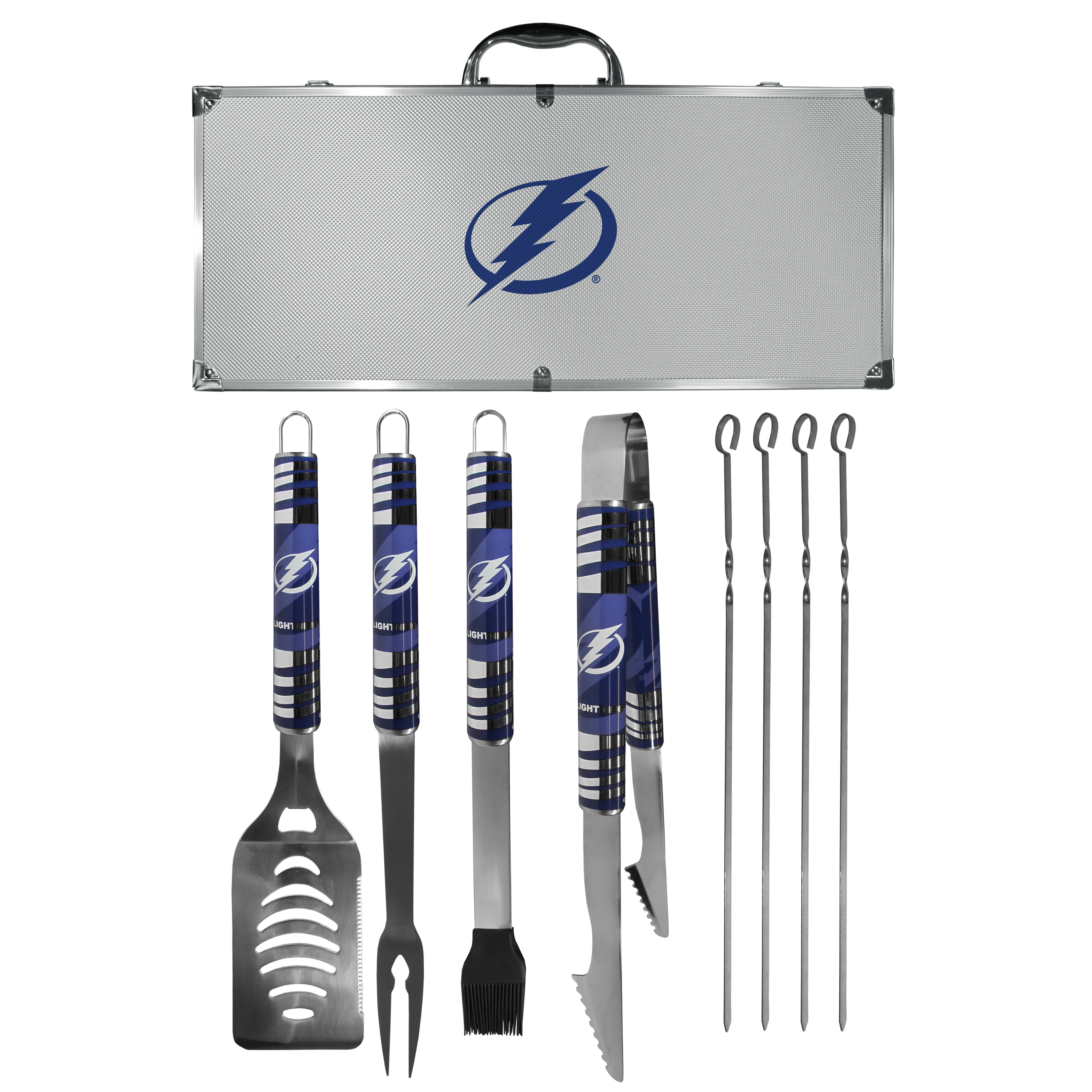 Tampa Bay Lightning® 8 pc Tailgater BBQ Set - This is the ultimate Tampa Bay Lightning® tailgate accessory! The high quality, 420 grade stainless steel tools are durable and well-made enough to make even the pickiest grill master smile. This complete grill accessory kit includes; 4 skewers, spatula with bottle opener and serrated knife edge, basting brush, tongs and a fork. The 18 inch metal carrying case is perfect for great outdoor use making grilling an ease while camping, tailgating or while having a game day party on your patio. The tools are 17 inches long and feature vivid team graphics. The metal case features a large team emblem with exceptional detail. This high-end men's gift is sure to be a hit as a present on Father's Day or Christmas.