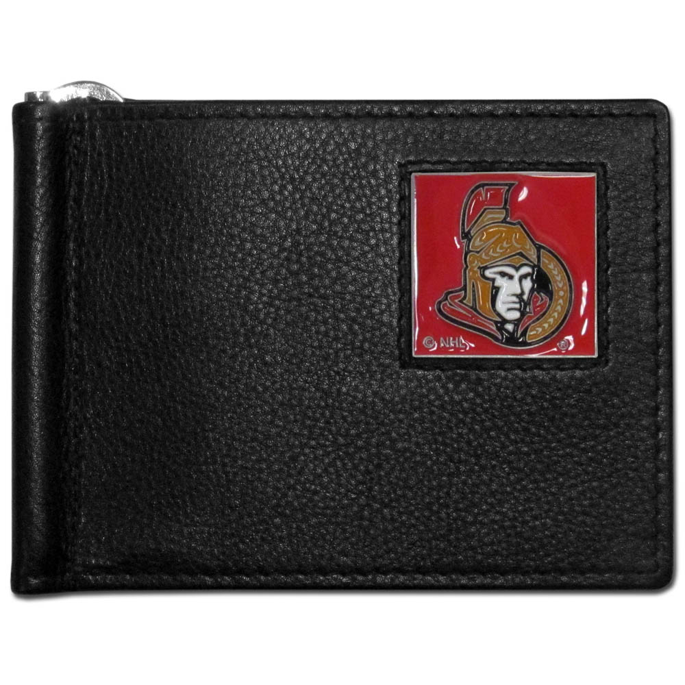 Ottawa Senators® Leather Bill Clip Wallet - This cool new style wallet features an inner, metal bill clip that lips up for easy access. The super slim wallet holds tons of stuff with ample pockets, credit card slots & windowed ID slot. The wallet is made of genuine fine grain leather and it finished with a metal Ottawa Senators® emblem. The wallet is shipped in gift box packaging.