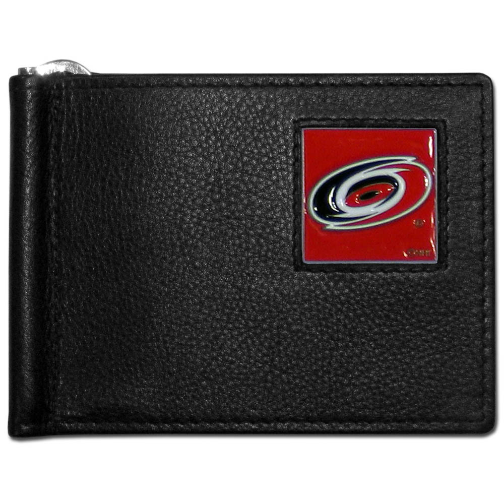 Carolina Hurricanes® Leather Bill Clip Wallet - This cool new style wallet features an inner, metal bill clip that lips up for easy access. The super slim wallet holds tons of stuff with ample pockets, credit card slots & windowed ID slot. The wallet is made of genuine fine grain leather and it finished with a metal Carolina Hurricanes® emblem. The wallet is shipped in gift box packaging.