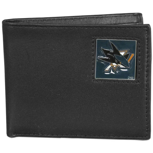 NHL Bifold Wallet in Box - San Jose Sharks - Our  NHL Bi-fold wallet is made of high quality fine grain leather and includes credit card slots and photo sleeves. Team logo is sculpted and enameled with fine detail on the front panel. Packaged in a window box that can be placed on a shelf or hung by a peg.