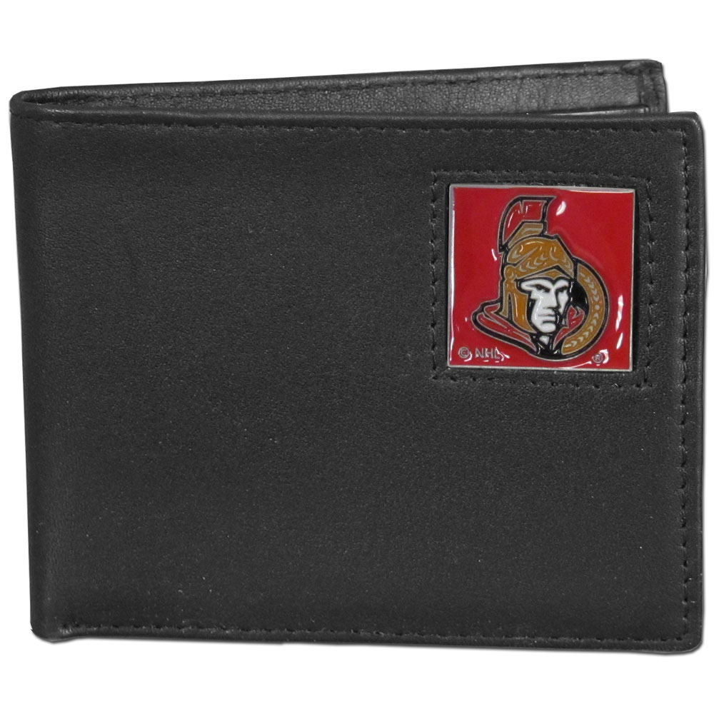 Ottawa Senators® Leather Bi-fold Wallet - Our officially licensed fine grain leather bi-fold wallet features numerous card slots, large billfold pocket and flip up window ID slot. This quality wallet has an enameled Ottawa Senators® emblem on the front of the wallet.
