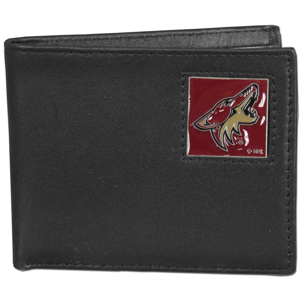 Arizona Coyotes® Leather Bi-fold Wallet - Our officially licensed fine grain leather bi-fold wallet features numerous card slots, large billfold pocket and flip up window ID slot. This quality wallet has an enameled Arizona Coyotes® emblem on the front of the wallet.